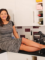 Hot MILF playing in the kitchen